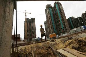 """Deserted construction or """"ghost cities"""". Local governments are buckling under debt from building such cities. (Reuters)"""