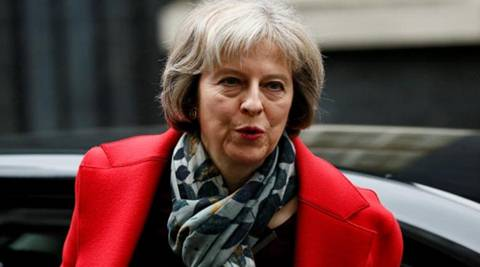 Britain will make a clean break from the European Union and not seek to remain ''half-in, half-out,'' signals Prime Minister Theresa May. (Reuters)