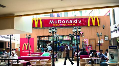 The fast-food company owns just under 50 percent of its Japanese unit, and is looking to sell up to 33 percent, with bids due next week, the report said.  (Reuters)