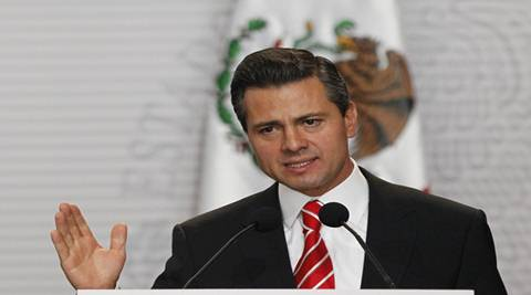 """Hours after Trump repeated his warnings against Mexico during a press conference, Pena Nieto said his government will seek """"open and complete negotiations"""" with the next US government. (Reuters)"""