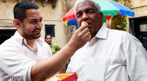 The prime perpetrator behind this cycle, their father and coach Mahavir Singh Phogat, is the central figure in Saurabh Duggal's Akhada. (Source: IE)