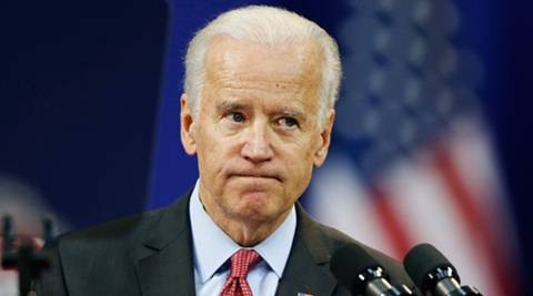 """""""The Crimea-related sanctions against Russia must remain in place until Russia returns full control to the people of Ukraine,"""" Biden said.   (Reuters)"""