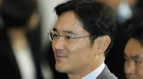 """Lee Jae-Yong and his lawyer were greeted by scores of journalists as well as dozens of protesters waving banners and chanting """"arrest Lee immediately"""" and calling him a """"co-culprit"""" in the scandal."""
