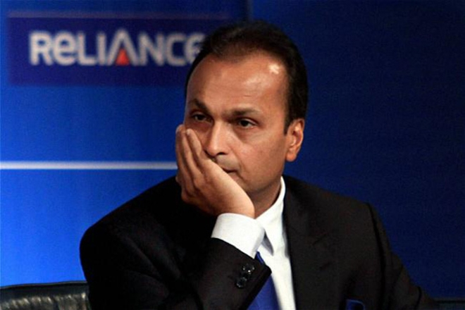 Anil Ambani, Reliance Communications Ltd, wireless operator, repay debt, $300 million, junk rated note, Hong Kong, stock sank, Fitch Ratings, Lucror Analytics, liquidity crunch