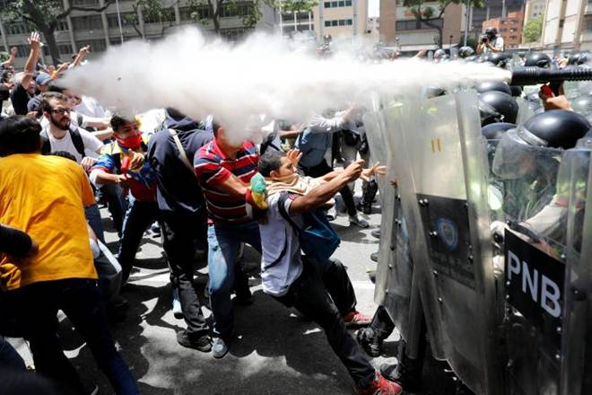 Venezuela, Riot police, military installation, tear gas, water cannon, protest, protesters