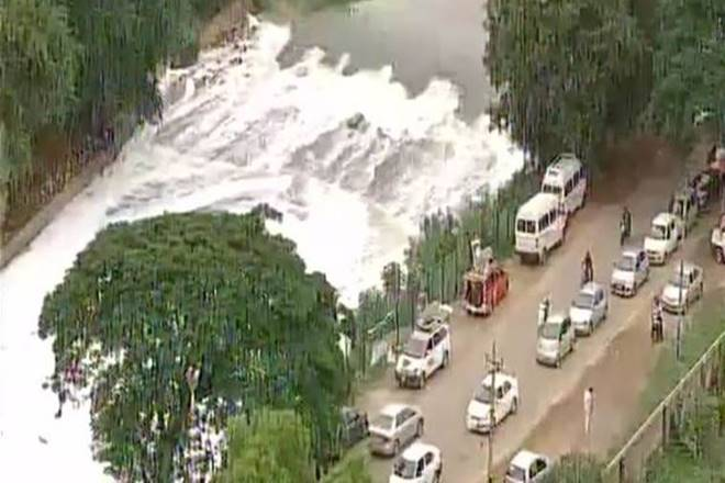 Bellandur lake, Bengaluru, polluted lake, smoke and flames, foam