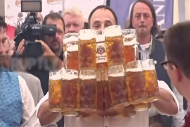 Beer, Germany, man creates record by carrying beer mugs, man breaks previous record