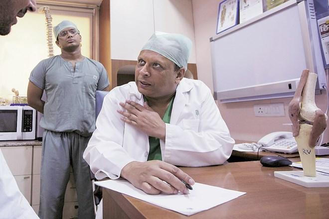 Nomura on Apollo Hospitals stock rating, nomura, apollo hospital stock,AHLL,Ebitda,ARPOB, ALOS, Navi Mumbai
