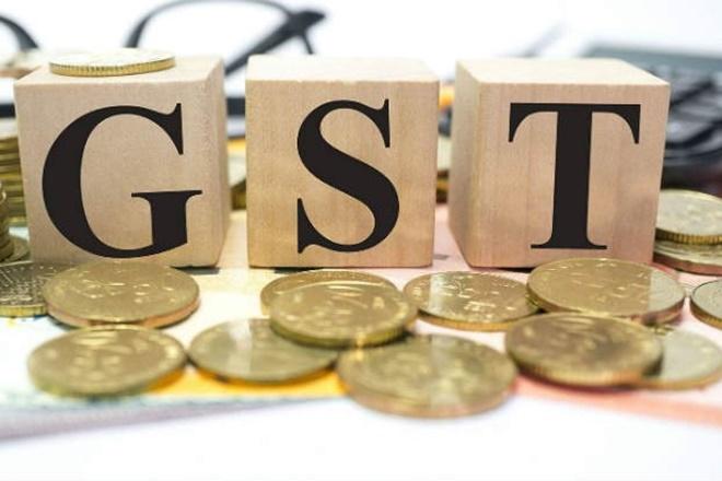 Naredco,GST,Hasmukh Adhia,MoS for finance & shipping,GST rate,finance secretary,input tax credit,Rajeev Talwar