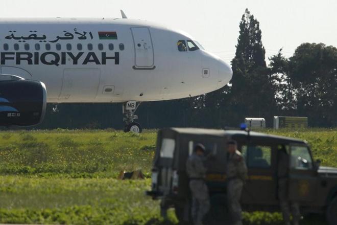 airport attack, attack in libiya airport, afriqiyah airways,afriqiyahairways flights suspended,afriqiyahairways flights cancelled, metiga airport,Tripoli Metiga international airport