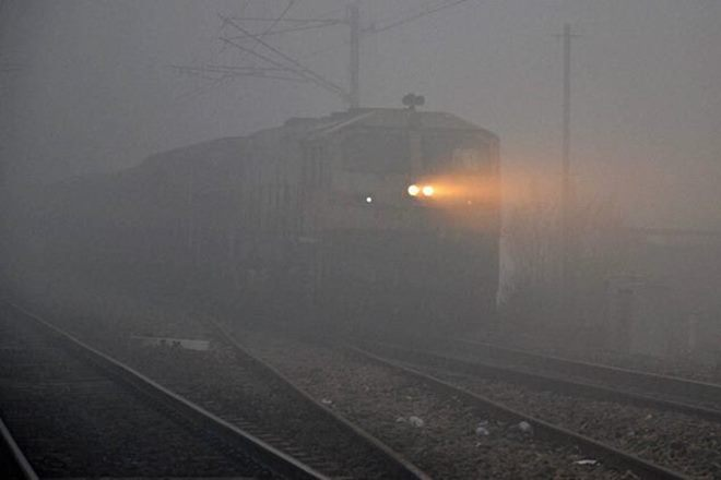 delhi temperature, delhi weather, temperature in delhi, railways schedule, railways status, train status, delhi trains, trains cancelled, trains delayed, delhi fog
