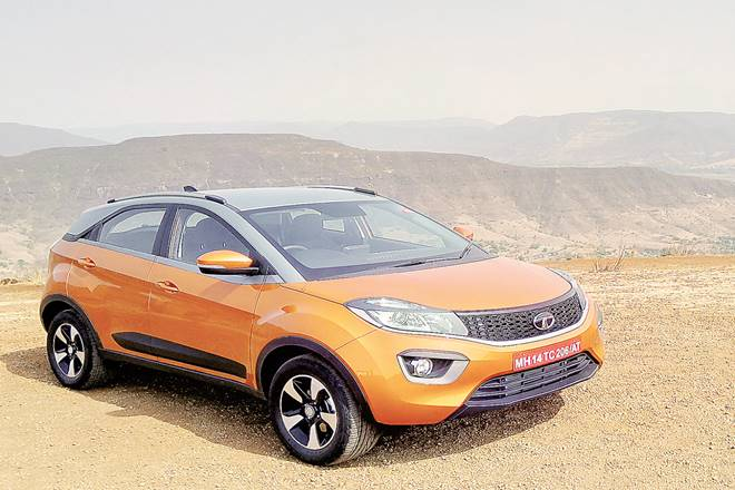 Car review of Tata Nexon AMT, price of Tata Nexon AMT, features of  Tata Nexon AMT, tesla,  Tata Motors