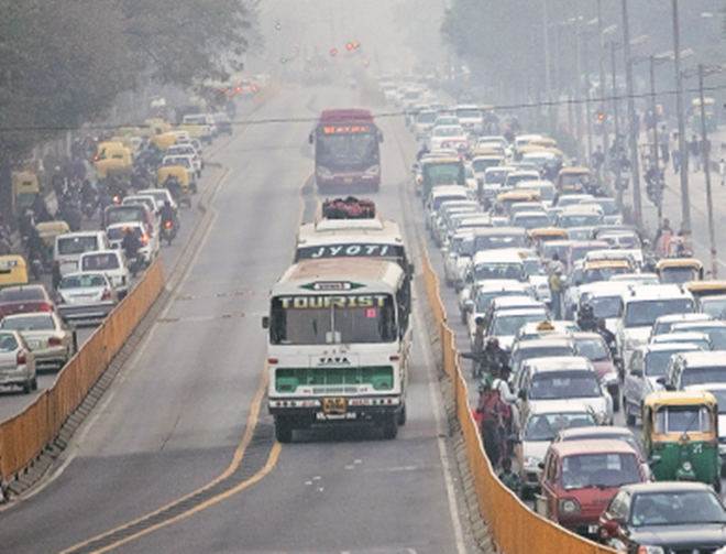 Cars and buses work their way through traffic in New Delhi. China and India may look like large pollutants, but if the amount of pollution is divided by the population and then compared with developed countries, one would get a very different picture, says the author (Bloomberg)