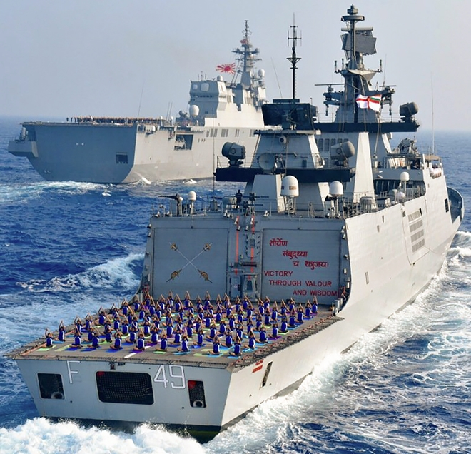 Indian Navy personnel perform yoga on INS Sahyadri to mark the International Yoga Day, off Guam, a major US Naval Base in the Western Pacific on Thursday.