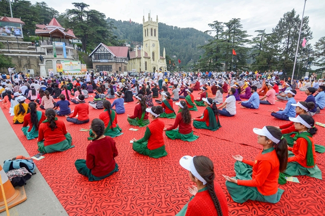 People perform yoga to mark the 4th International Day of Yoga 2018 in Shimla on Thursday. (PTI Photo)