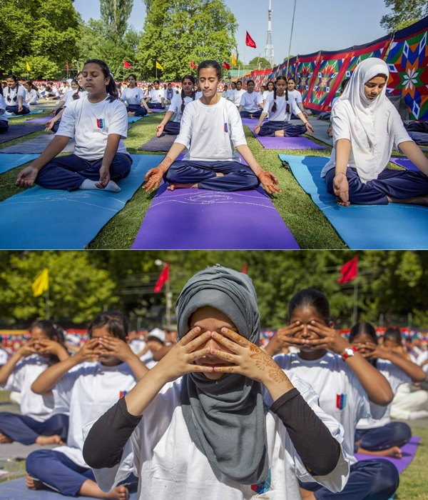 Students perform yoga to mark the 4th International Day of Yoga in Srinagar on Thursday.